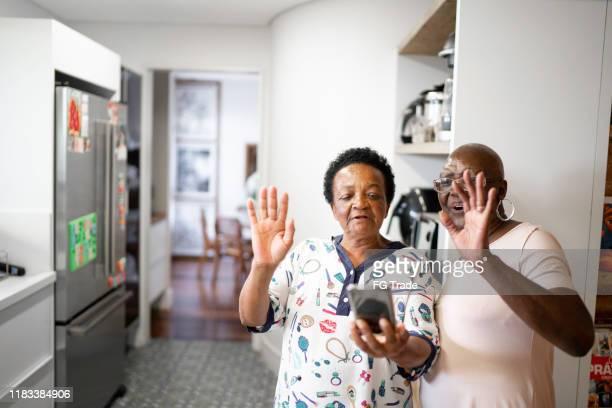 Senior women doing a video call using smartphone