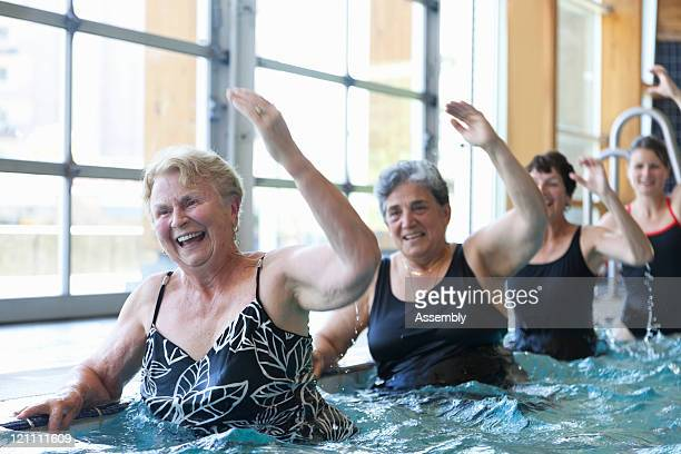 Senior women doing aquacise in pool