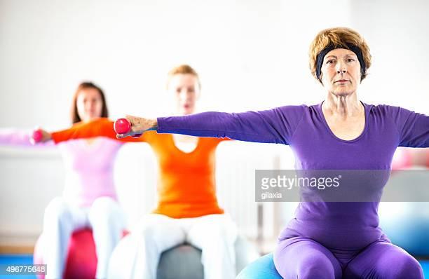 Senior women doing Pilates.
