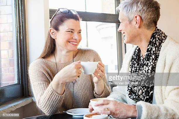 Senior women drinking coffee in cafe.