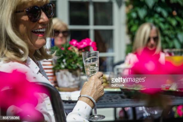 Senior Women Drinking Wine in the Garden