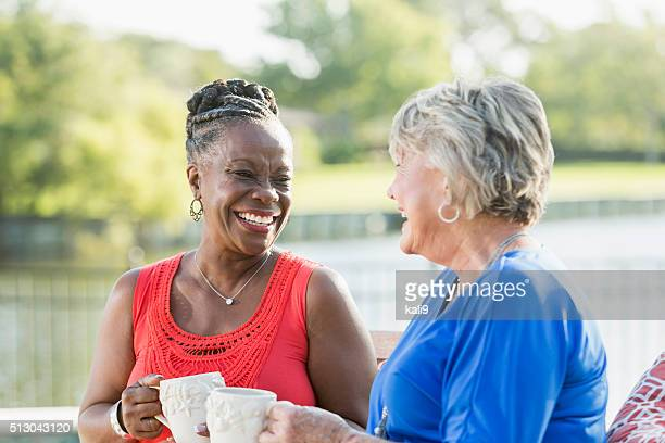 Senior women enjoying cup of coffee in back yard
