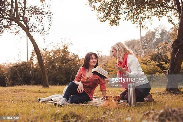 Senior women enjoying cup of coffee together