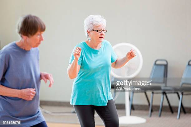 Senior women enjoying line dancing