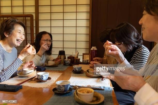5 senior women enjoying meal together - washoku stock pictures, royalty-free photos & images
