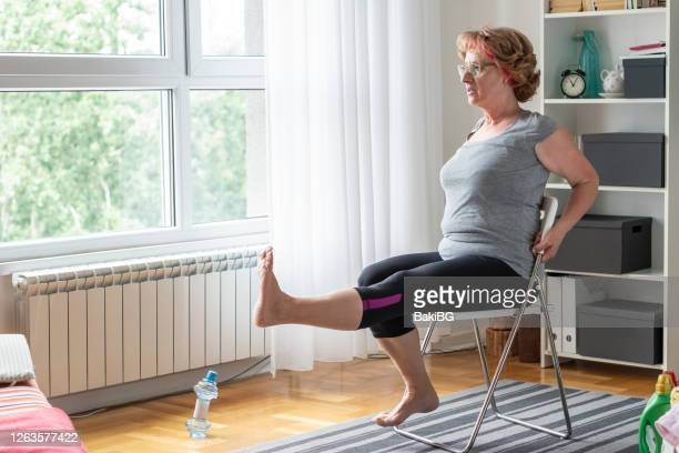 senior women exercise at home - chair stock pictures, royalty-free photos & images