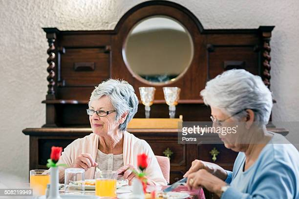 Senior women having breakfast in nursing home