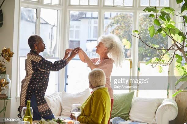 Senior women having fun dancing together