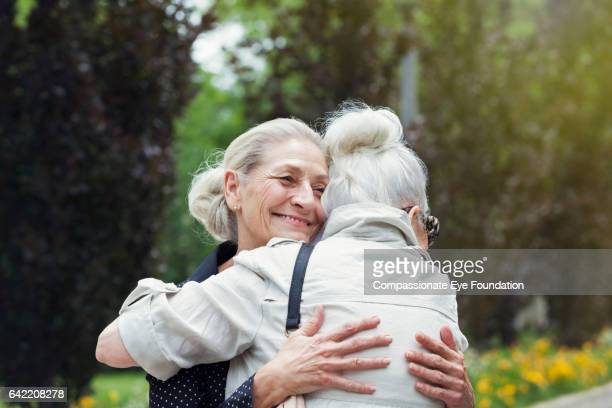Senior women hugging in park