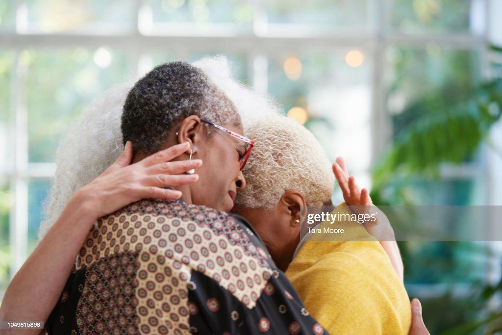 senior women hugging : Stock Photo