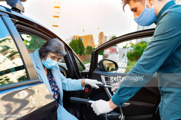 senior women in a car with caregiver - persons with disabilities stock pictures, royalty-free photos & images