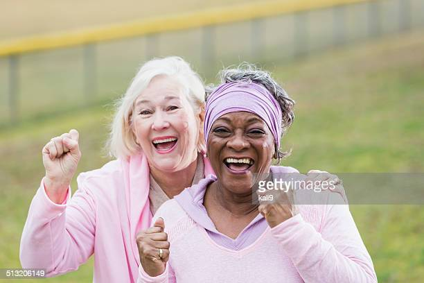 senior women in pink - human rights stock pictures, royalty-free photos & images