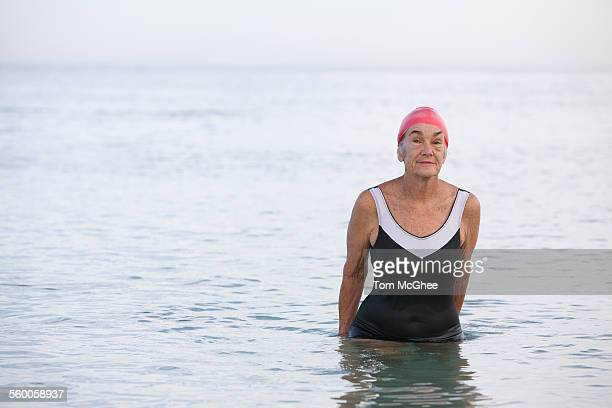 senior women in water up to her waist - wading stock pictures, royalty-free photos & images