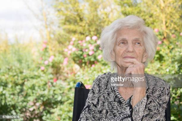 Senior Women Lost in Thoughts in Wheel Chair