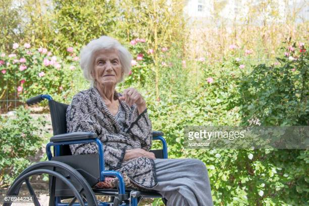 senior women lost in thoughts in wheel chair - 90 plus years stock pictures, royalty-free photos & images