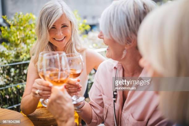 senior women on holidays toasting with wine during wine tasting - wine tasting stock photos and pictures