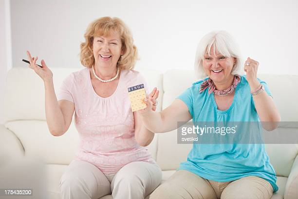Senior women playing bingo.