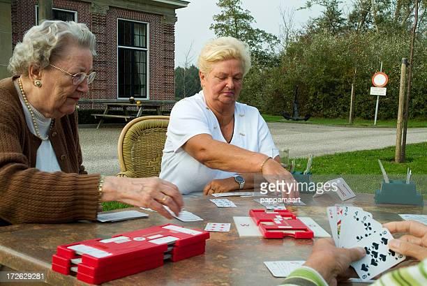 Senior women playing bridge