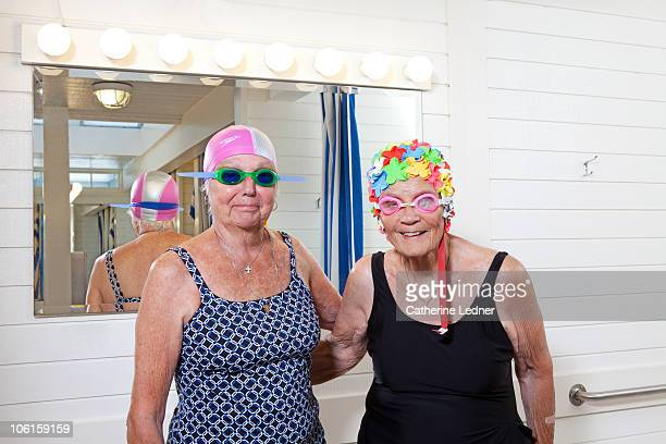 Senior women posing in bathing suits and goggles