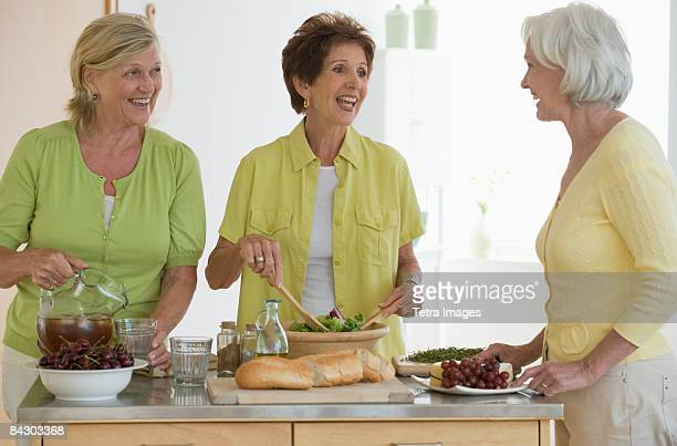 Senior women preparing food