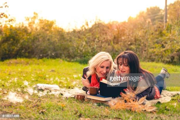 Senior women reading book together