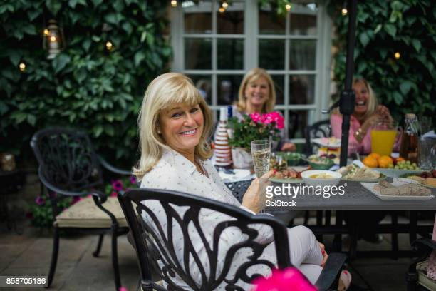 Senior Women Relaxing with Drinks Outdoors