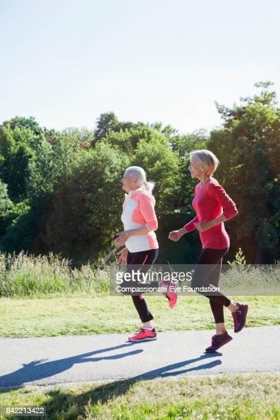 Senior women running in park
