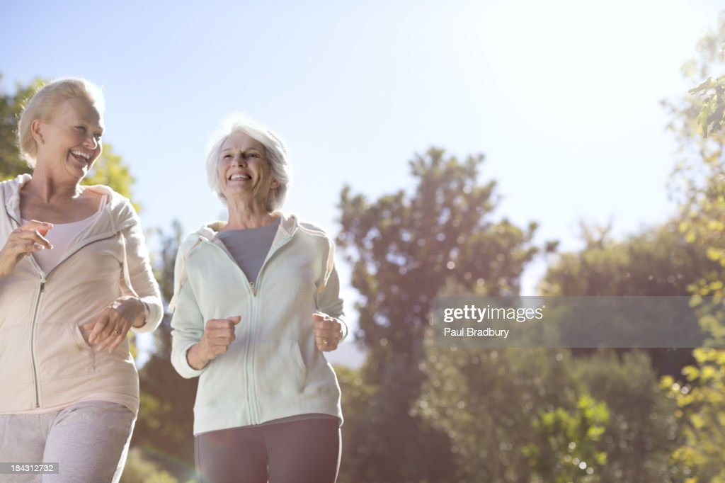 Senior women running outdoors : Stock Photo