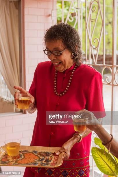 Senior Women serving Juice
