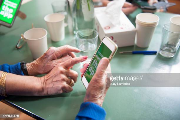 Senior women support group, learning about a new app