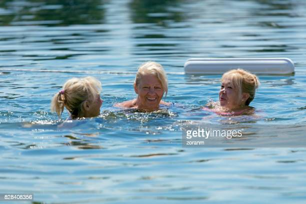 senior women swimming in lake - sea swimming stock photos and pictures