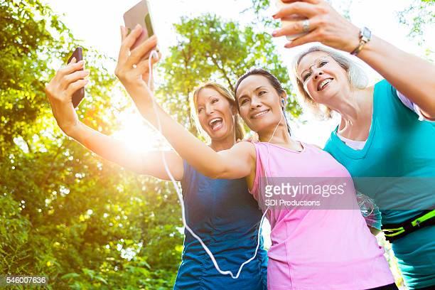 Senior women take selfie while exercising