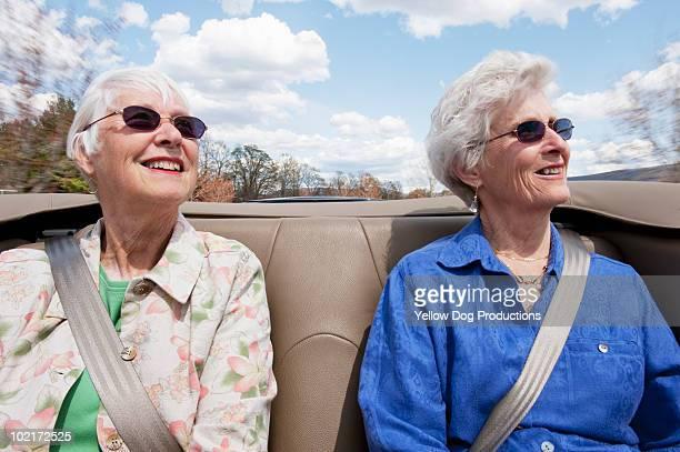 Senior women taking car ride in convertible