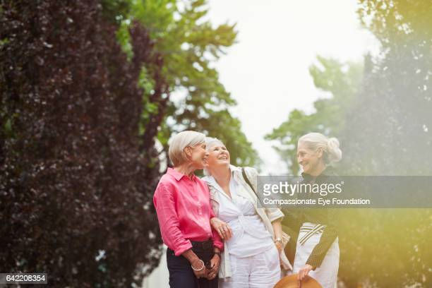 Senior women talking in park