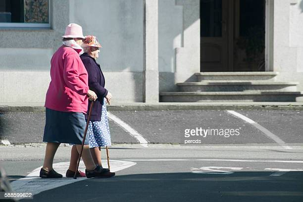 Senior women walking in a city street