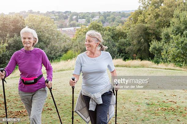 Senior women walking with nordic walking poles.
