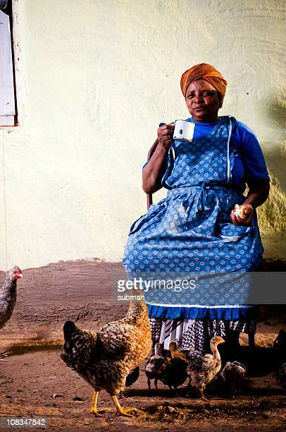 Senior Xhosa woman having rusks and coffee