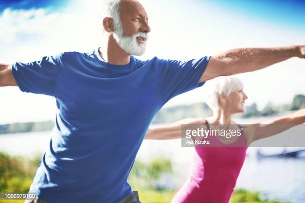 senior yoga. - zen like stock pictures, royalty-free photos & images