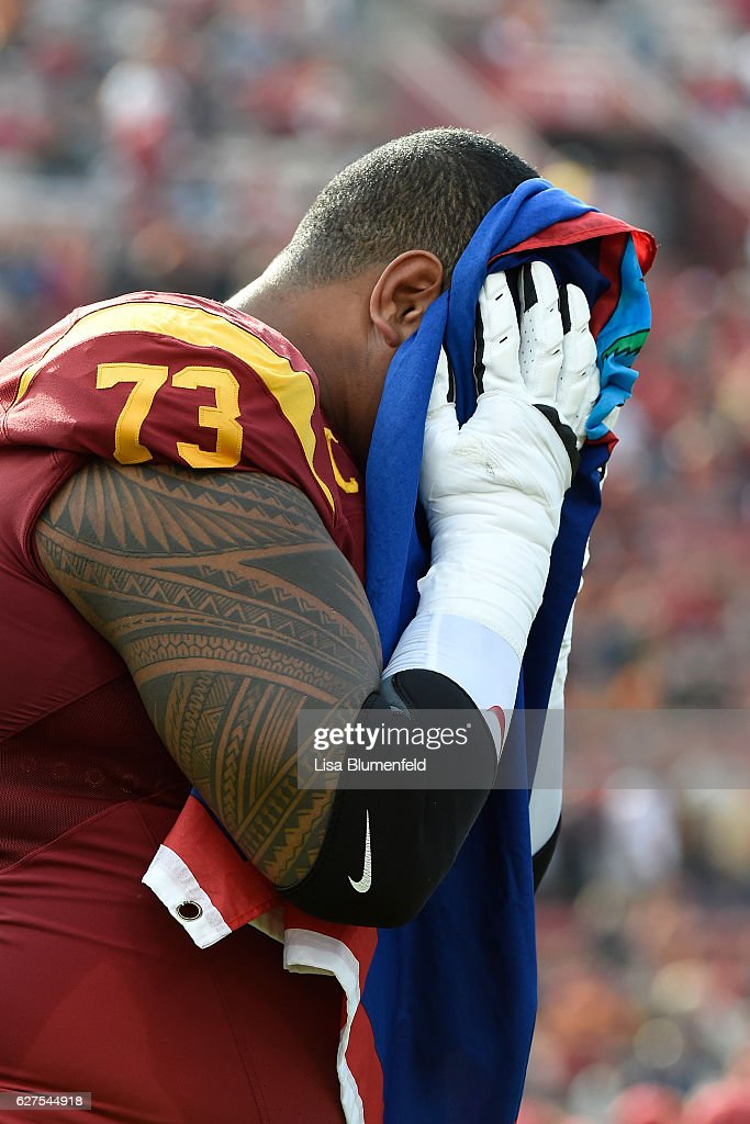Senior Zach Banner #73 of the USC Trojans has an emotional moment on the field before the game against the Notre Dame Fighting Irish at Los Angeles Memorial Coliseum on November 26, 2016 in Los Angeles, California.