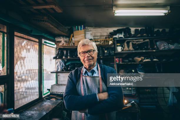 seniorpreneur - shoemaker stock photos and pictures