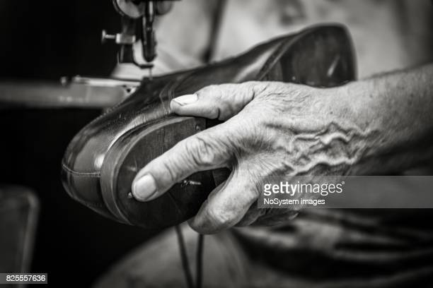 seniorpreneurs - shoemaker stock photos and pictures