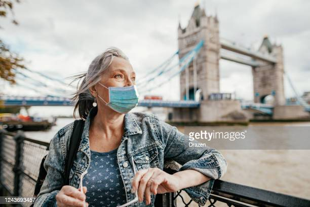 seniors and traveling after coronavirus pandemic - central london stock pictures, royalty-free photos & images