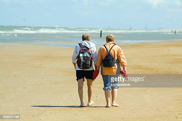 seniors are dandering at beach - west flanders stock pictures, royalty-free photos & images