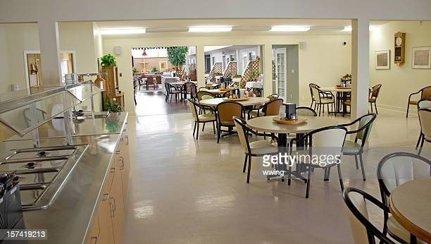 senior's assisted living home dining area - dining room stock photos and pictures