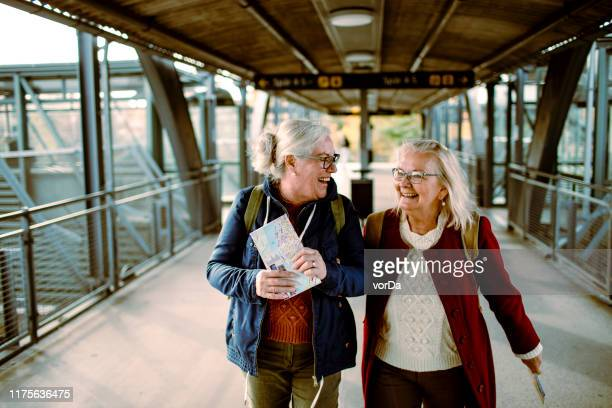 seniors at a train station - railway station stock pictures, royalty-free photos & images