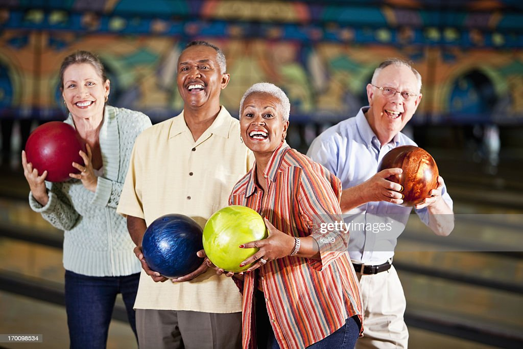 Seniors at bowling alley : Stock Photo