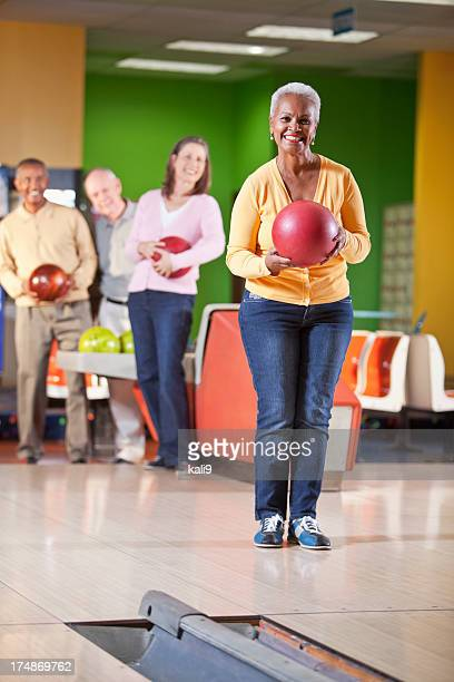 seniors at bowling alley - black alley stock photos and pictures