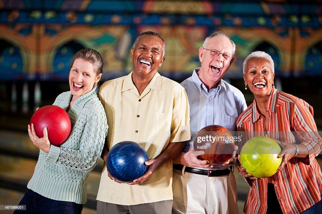Seniors at bowling alley : Stock Photo