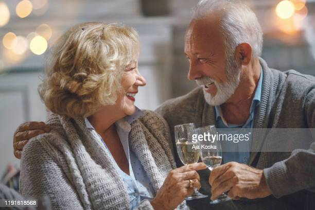 seniors at new year's eve party. - 63 year old female stock pictures, royalty-free photos & images