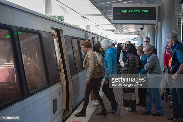 Seniors board a Metro train at the WiehleReston East Metro station during a handson learning session on the bus and Metrorail on Oct 6 2015 in Reston...
